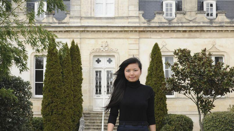 Li Lijuan, in charge of managing the Grand Moueys property, walks in front of the Chateau du Grand Moueys in Capian