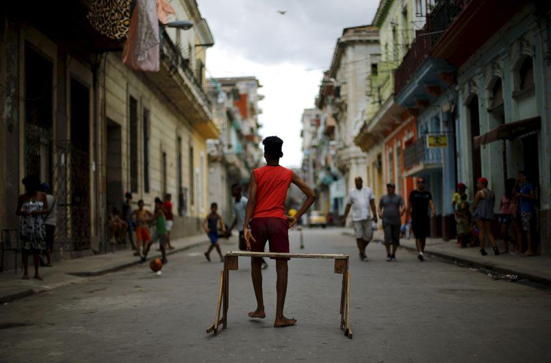Children play soccer on a street in Havana