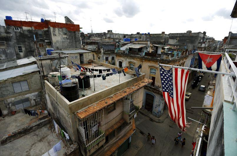 U.S. and Cuban flags are seen on a balcony in Havana