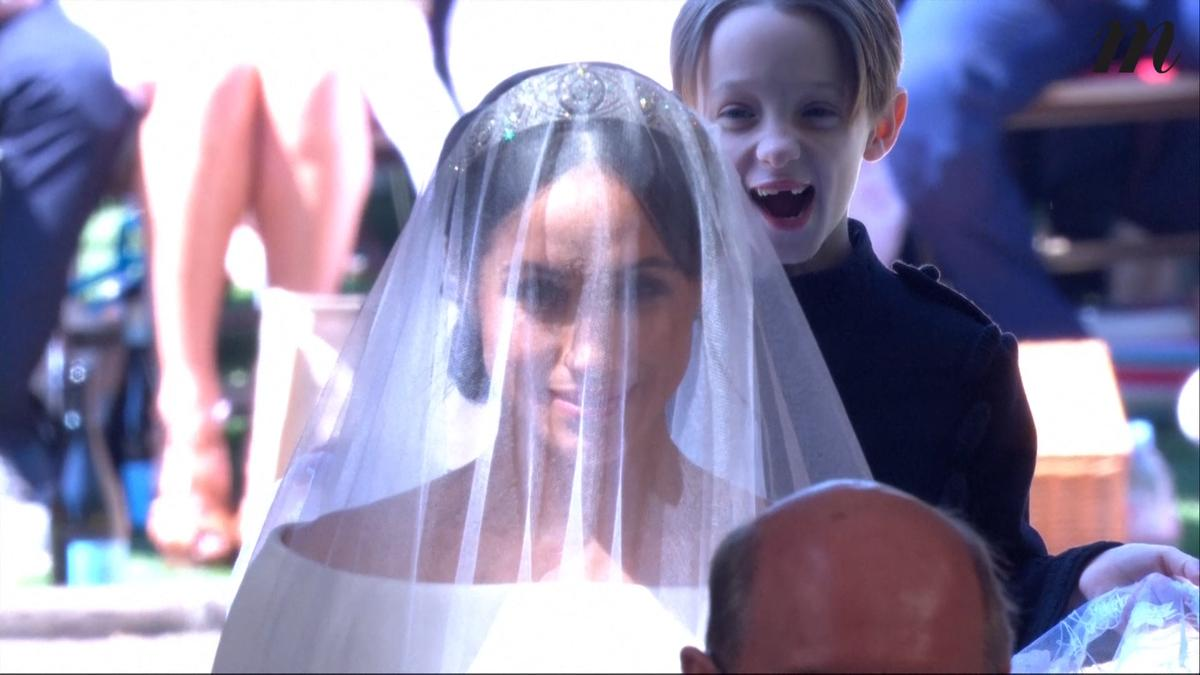 Le petit garçon rieur derrière Meghan Markle, l'autre star du mariage princier