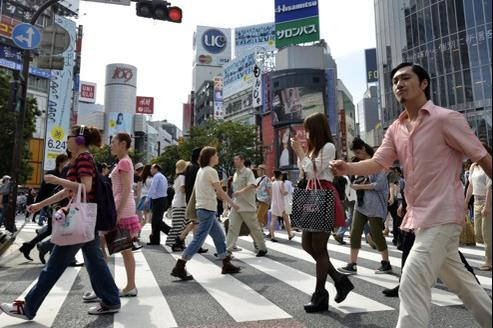 Devant la gare de Shibuya, à Tokyo, en juin dernier.