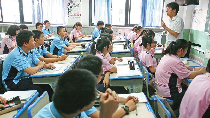 Des étudiants suivent un cours dans un lycée de Shanghaï. Le projet pilote de la ville dans l'éducation a vocation à être reproduit à une échelle plus large dans toute la Chine.