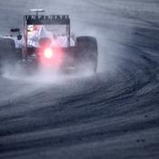 Sébastian Vettel, en pole malgré la pluie