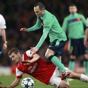 Arsenal-Barcelone Wilshere tacle Iniesta