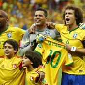 David Luiz (R) and Julio Cesar (2nd R) hold up a Neymar shirt before the match
