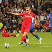 Salzburg's Norwegian forward Erling Braut Haland scores during the UEFA Champions League Group E football match Salzburg v Genk in Salzburg, Austria