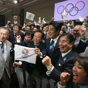 La joie de la délégation de Tokyo