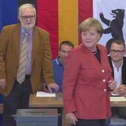 Les allemands se rendent aux urnes pour des élections législatives jouées d'avance