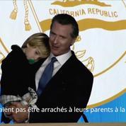 Le nouveau gouverneur de Californie fait son discours d'investiture avec son fils dans les bras