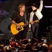 Nicole Kidman se déhanche sur scène au concert de son mari