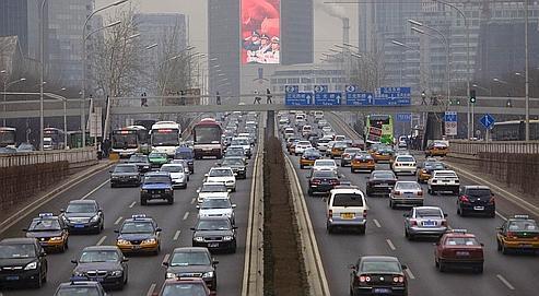 Une rue de Beijing, en Chine, en février dernier. Hu Jintao a annoncé mardi une réduction «des émissions de dioxyde de carbone par point de croissance économique d'ici à 2020 comparativement à leur niveau de 2005».