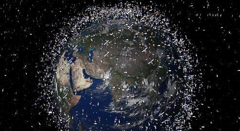 Vision d'artiste simulant les débris qui tournent actuellement à 2000 kmau-dessusde la Terre. Crédits photo: European Space Agency