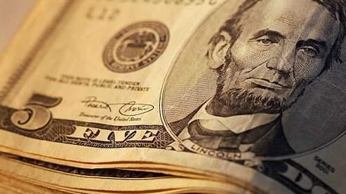 Liasse de billets de 5 dollars . Crédit: photo8.com