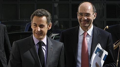 Nicolas Sarkozy en compagnie d'Eric Woerth, en avril 2008.