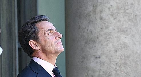 Nicolas Sarkozy surleperron de l'Élysée, jeudi.