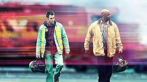 Pour les besoins du film, Denzel Washington n'a pas hésité à courir sur le toit d'un train lancé à 80 km/heure. (20th Century Fox)