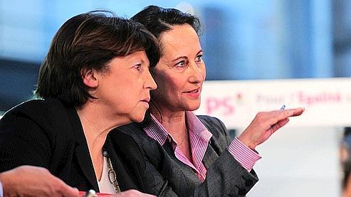 Martine Aubry (gauche) et Ségolène Royal (droite) samedi à la convention sur l'égalité réelle du PS.