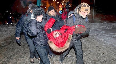 Dimanche soir, place d'Octobreà Minsk,le candidatde l'opposition, Vladimir Nekliaev,a été blessé.