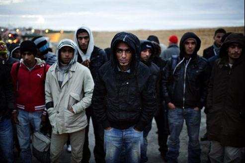 Migrants sur l'île italienne de Lampedusa, le 21 février. AFP PHOTO / ROBERTO SALOMONE