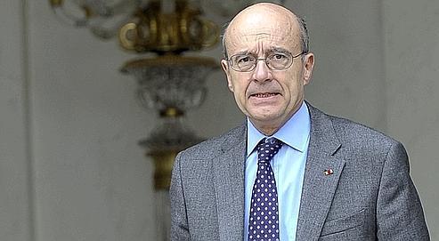 Le ministre des Affaires étrangères Alain Juppé, mercredi à la sortie de l'Élysée après le Conseil des ministres.