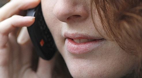 Le Centre international de recherche sur le cancer (Circ) de l'OMS a estimé mardi que l'usage des téléphones portables devait être considéré comme «peut-être cancérogène pour l'homme». Crédits photo : LUKE MACGREGOR/REUTERS.