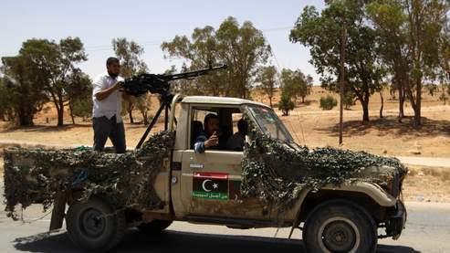 Dans le Djebel Nefousa, les combattants rebelles et leurs sympathisants ont «saccagé des biens, brûlé certaines habitations, pillé des hôpitaux», selon HRW.