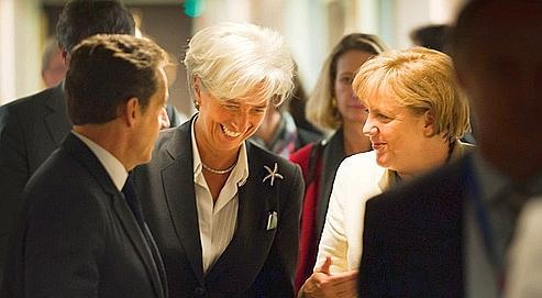 Nicolas Sarkozy, Christine Lagarde et Angela Merkel jeudi soir.