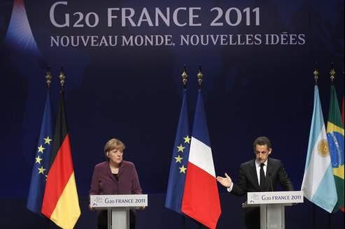 Nicolas Sarkozy et Angela Merkel à la veille du G20 à Cannes, mercredi soir.
