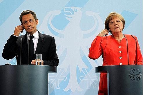 Nicolas Sarkozy et Angela Merkel (à Berlin, le 3 novembre dernier) ont rappelé samedi au nouveau gouvernement grec l'urgence des mesures engagées.