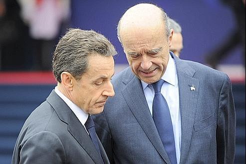 Nicolas Sarkozy et Alain Juppé à leur arrivée au sommet du G20, le 3 novembre, à Cannes.