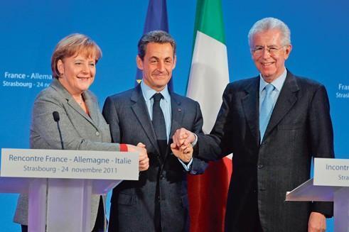 Le président Nicolas Sarkozy, entouré de la chancelière Angela Merkel et du président du Conseil italien Mario Monti, en novembre dernier, à Strasbourg.