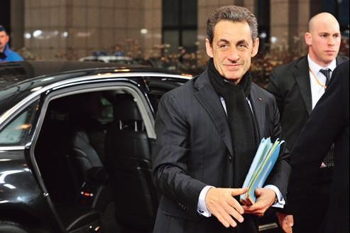 Nicolas Sarkozy, lundi à Bruxelles, à son arrivée au sommet européen.