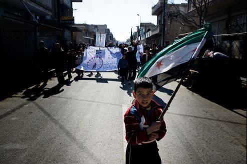 Les enfanst aussi sont victimes des la répression du régime. Ce garçonnet manifeste contre Bachar el-Assad le 3 février.