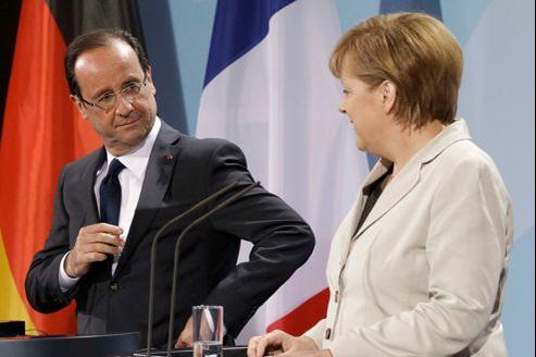 François Hollande et Angela Merkel, mardi à Berlin, lors de leur conférence de presse commune.