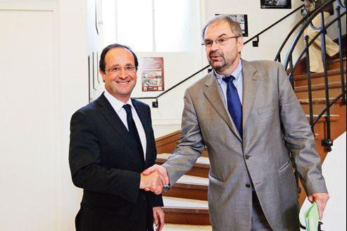 François Hollande au côté de François Chérèque, secrétaire général de la CFDT, en mars 2012.
