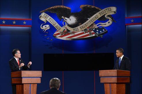 Les deux candidats, le Républicain Mitt Romney et le Démocrate Barack Obama lors du premier débat télévisé à Denver.