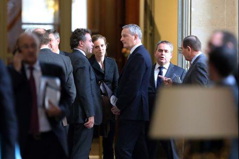 Luc Chatel, Nathalie Kosciusko-Morizet, Bruno Le Maire et Xavier Bertrand (de gauche à droite), après la session de questions au gouvernement, à l'Assemblée nationale, mercredi.