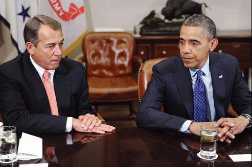 Homme de compromis, John Boehner, le speaker conservateur de la Chambre des représentants au Congrès, ici en discussion avec Barack Obama, pourrait être remis en cause par sa base, farouchement opposée à un accord.