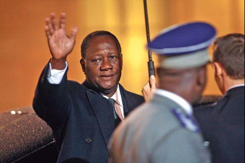 Le président de la Côte d'Ivoire, Alassane Ouattara, ici le 4 décembre, à l'Élysée, s'est dit confiant après sa visite à Paris et sa rencontre avec les investisseurs.