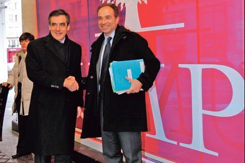 François Fillon et Jean-François Copé, le 19 janvier 2012, à l'occasion de la visite du premier ministre d'alors au nouveau siège de l'UMP à Paris.