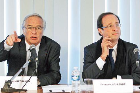 François Rebsamen, sénateur maire PS de Dijon, et François Hollande, lors d'une réunion à Dijon, en février 2012.