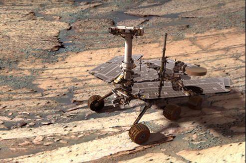 Vue d'artiste du rover Opportunity sur le fond du cratère Endurance sur Mars.