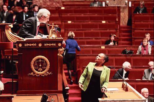 Christiane Taubira face au président de l'Assemblée nationale, Claude Bartolone, mardi lors de la première journée d'examen du texte sur le mariage pour tous.
