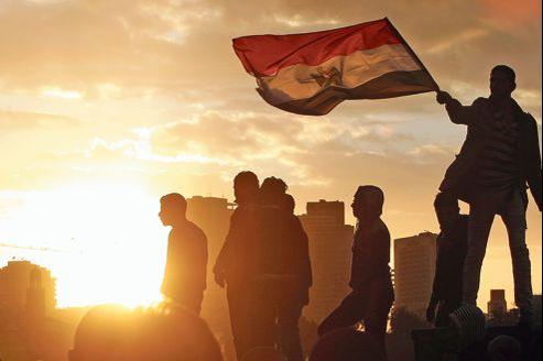 Des opposants à Mohammed Morsi, vendredi au Caire.
