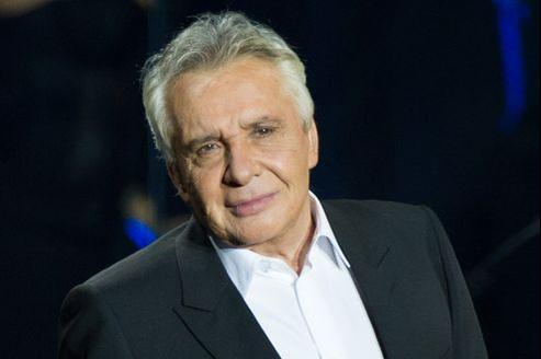 Michel Sardou est la cible de Johnny dans son autobiographie.