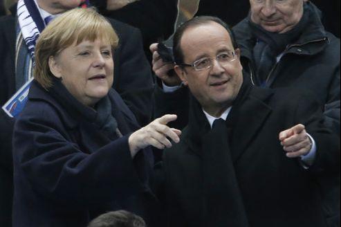 Angela Merkel et François Hollande, mercredi soir au Stade de France.