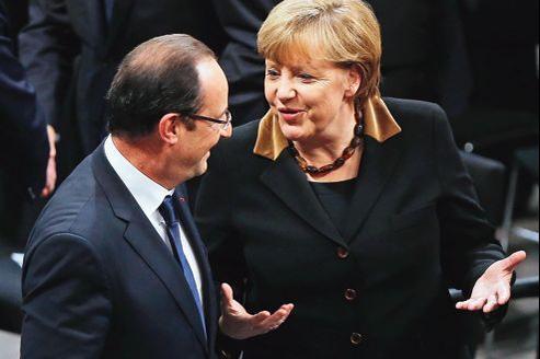 François Hollande et Angela Merkel, le 22 janvier au Reichstag, à Berlin, lors du 50e anniversaire du traité de l'Élysée.