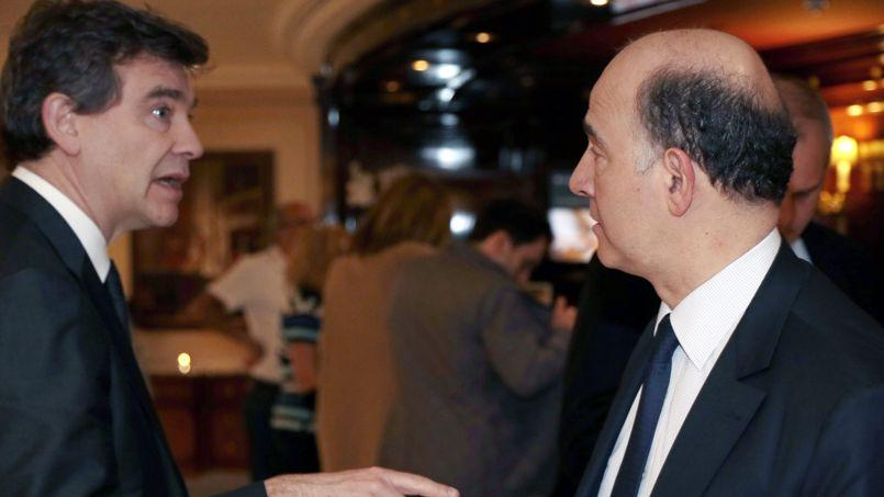 Le ministre du Redressement productif, Arnaud Montebourg (à gauche) et son collègue de l'Économie et des Finances, Pierre Moscovici