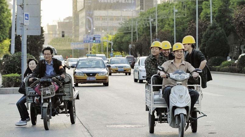 Fin de journée dans une rue de Pékin. Le pouvoir d'achat augmente et le coût du travail suit.