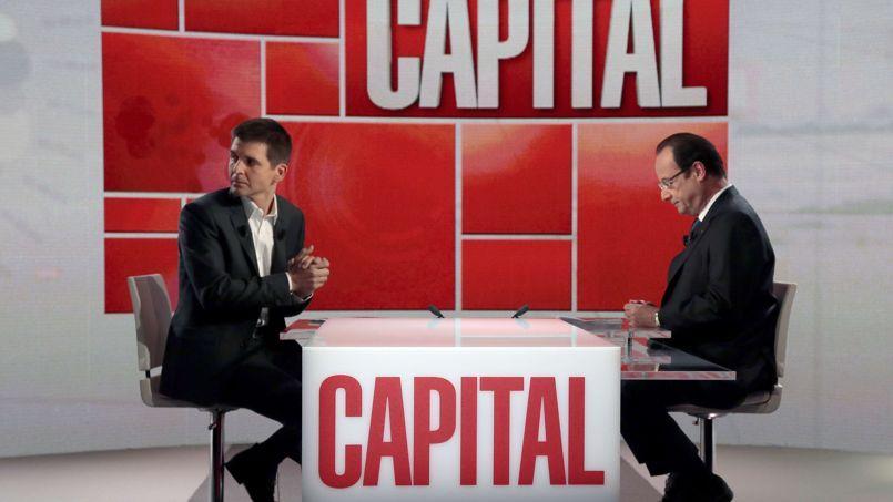 Le journaliste Thomas Sotto avec François Hollande.